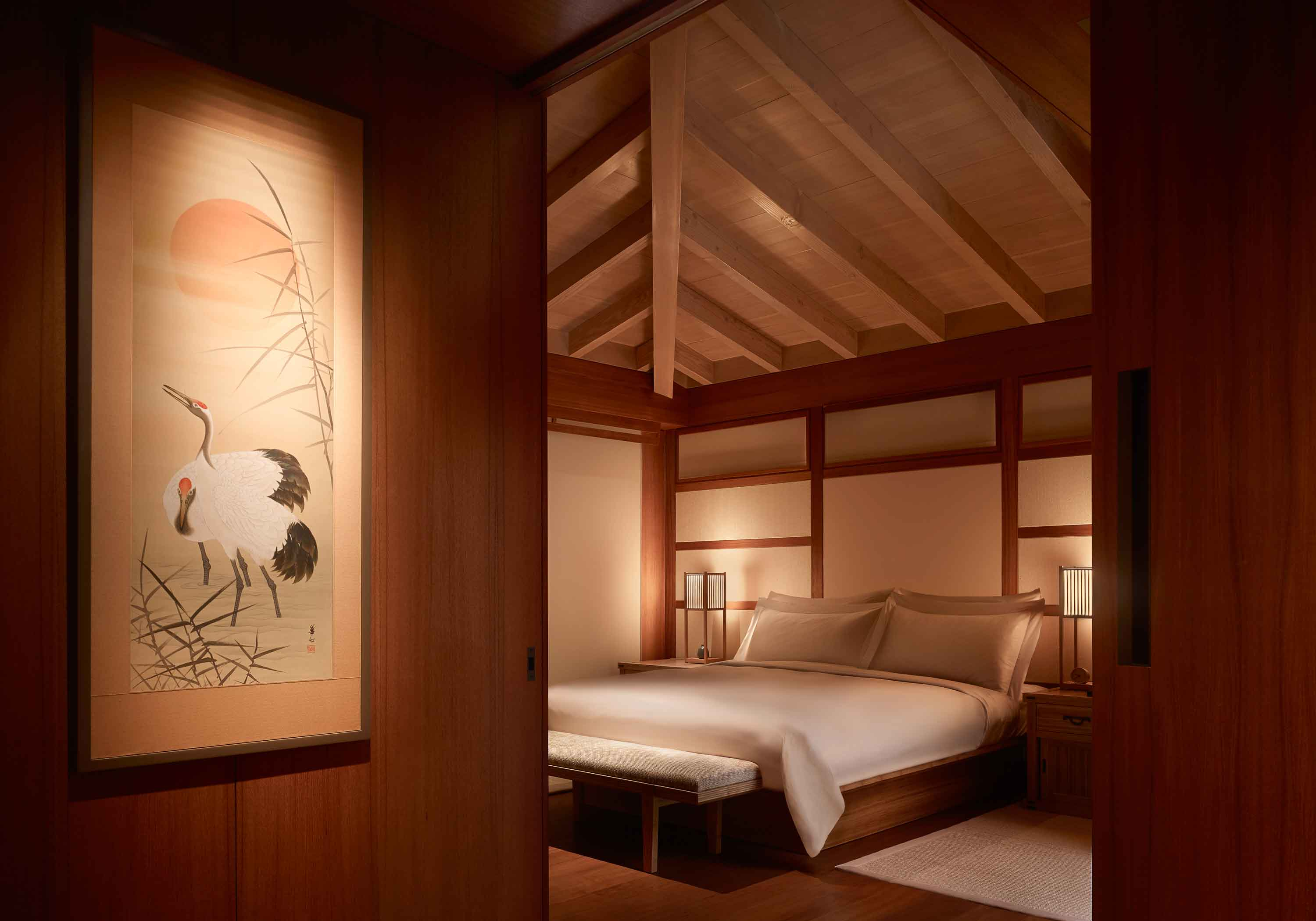 Inside of a bedroom at Nobu Ryokan Malibu with a bed, night stands and high ceilings